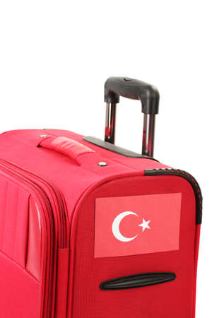 haversack: red suitcase with sticker with flag of Turkey isolated on white Stock Photo