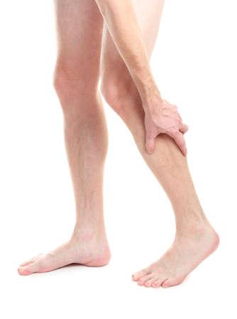 cramp: man holding sore knee, isolated on white Stock Photo