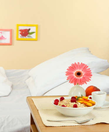 light breakfast on the nightstand next to the bed photo