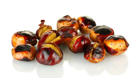 buckeye seed: some roasted chestnuts isolated on white
