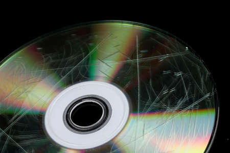 Defective disk with information isolated on black Stock Photo - 15624336