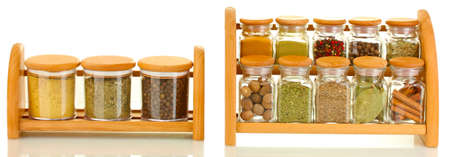 jars with spices on wooden shelfs isolated on white photo