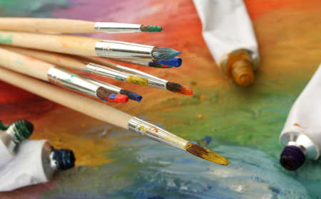 acrylic paint, paint tubes and brushes on wooden palette Stock Photo - 15664758