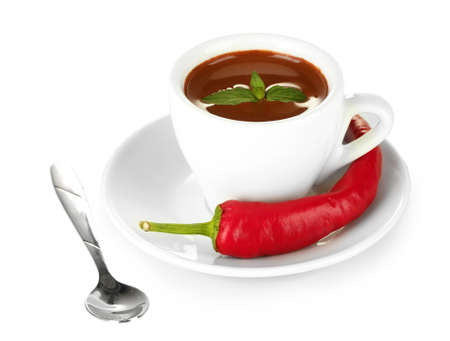 white cup with hot chocolate and chili pepper isolated on white photo