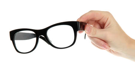 opthalmology: woman hand with black glasses, isolated on white