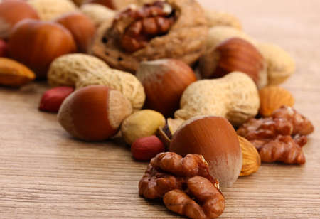 nut shell: assortment of tasty nuts on wooden background Stock Photo