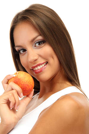 beautiful young woman with  peach, isolated on white photo