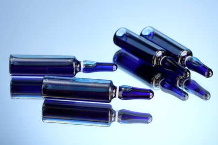 ampules: medical ampules on blue background Stock Photo