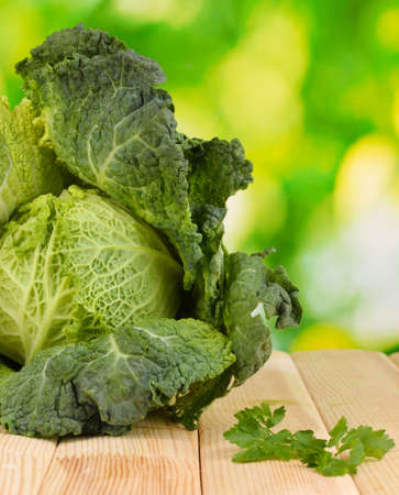 microelements: Fresh savoy cabbage on wooden table on natural background Stock Photo