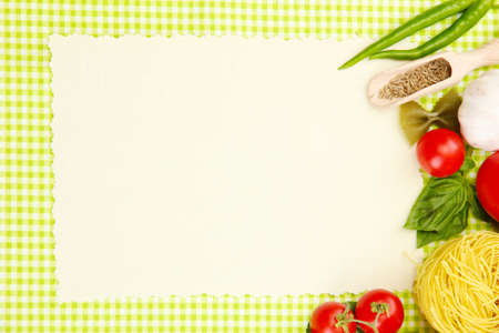 paper for recipes,vegetables and spices on green background photo
