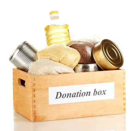 Donation box with food isolated on white photo