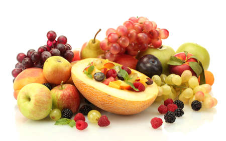fresh fruits salad in melon, fruits and berries, isolated on white Stock Photo - 15738287