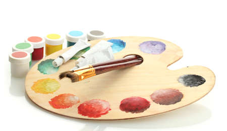 wooden art palette with paint and brushes isolated on white Stock Photo - 15737276