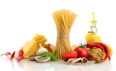 Pasta spaghetti, vegetables, spices and oil, isolated on white photo