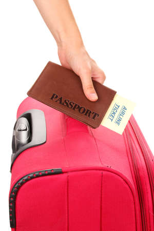 holding passport and suitcase in hand close-up Stock Photo - 15758719