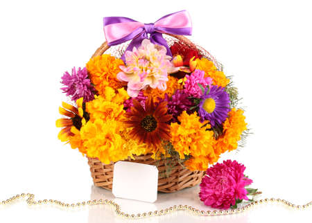 Beautiful bouquet of bright flowers in basket with paper note isolated on white photo