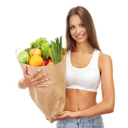 beautiful young woman with vegetables and fruits in shopping bag , isolated on white Imagens