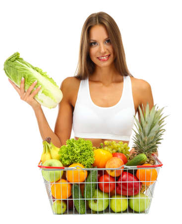 shopping basket: beautiful young woman with fruits and vegetables in shopping basket, isolated on white Stock Photo