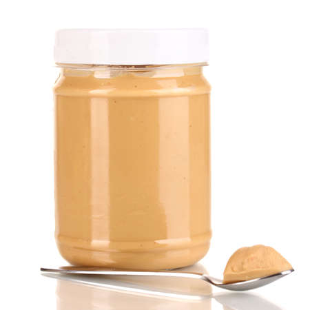 Delicious peanut butter in jar isolated on white Stock Photo - 15835034
