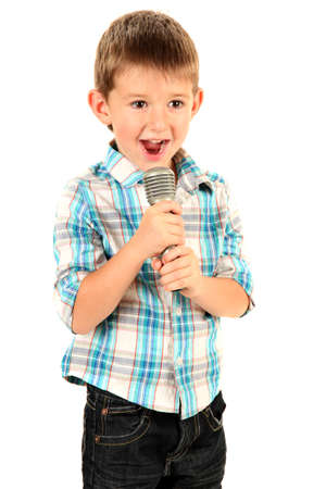 funny little boy with microphone, isolated on white photo