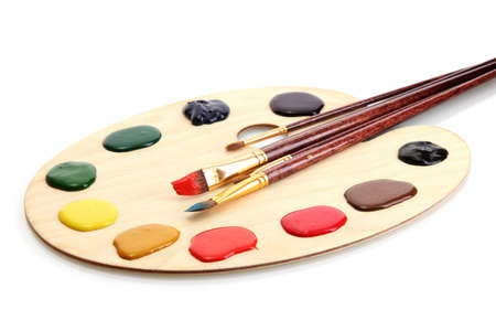 painting: wooden art palette with  paint and brushes isolated on white