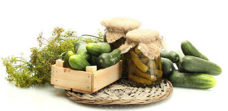 cuke: fresh cucumbers in wooden box, pickles and dill isolated on white