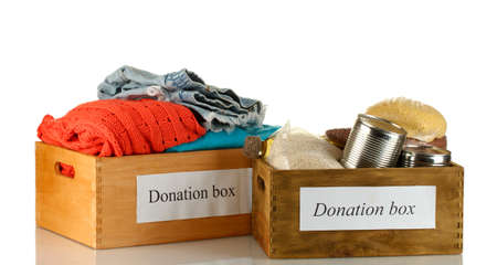 Donation boxes with clothing and food isolated on white photo