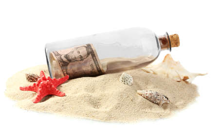 Glass bottle with note inside on sand isolated on white Stock Photo - 15742870