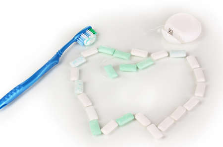 similarity: Chewing gum, dental floss and toothbrush isolated on white