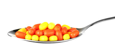 colorful pills on spoon on white background close-up Stock Photo - 15742658