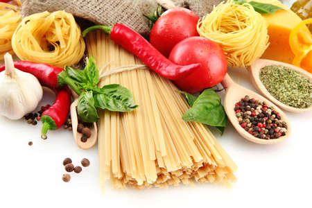 Pasta spaghetti, vegetables and spices, isolated on white Stock Photo - 15776930