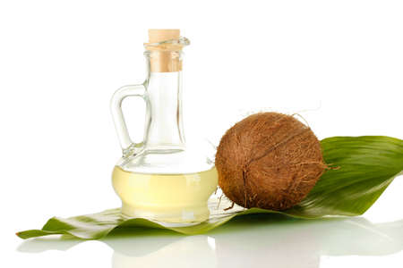 decanter with coconut oil and coconut isolated on white photo