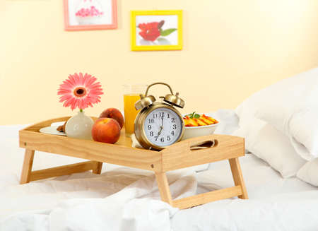ambiance: wooden tray with light breakfast on bed