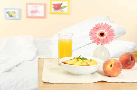 light breakfast on the nightstand next to the bed Stock Photo - 15742839