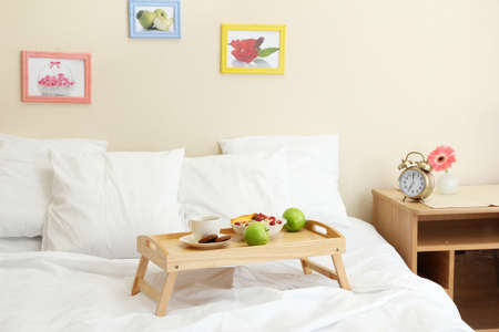 wooden tray with light breakfast on bed Stock Photo - 15742941
