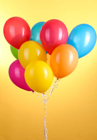 party balloons: Colorful balloons on yellow background Stock Photo