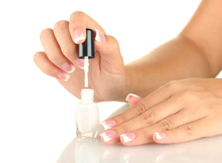 Woman makes herself a French manicure, on white background Stock Photo - 15764797