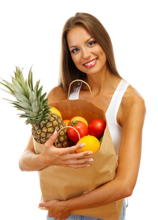 beautiful young woman with fruits in shopping paper bag, isolated on white photo