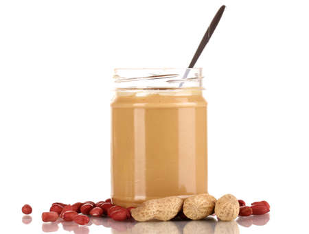 Delicious peanut butter in jar isolated on white Stock Photo - 15764730