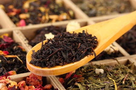 assortment of dry tea in wooden box, close up photo