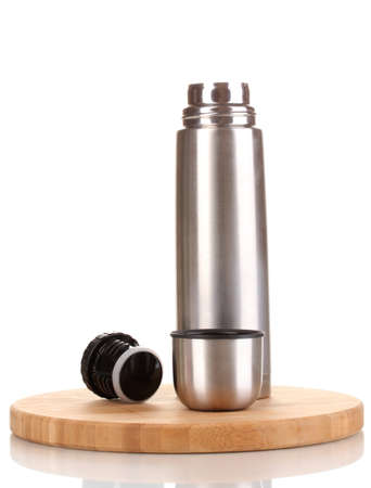 airtight: metal thermos on wooden board isolated on white