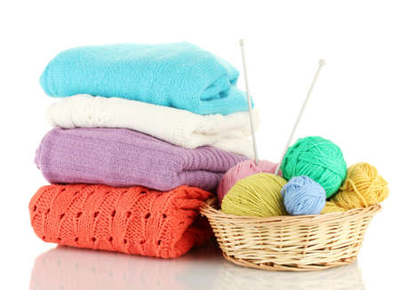 basket embroidery: Sweaters and balls of wool isolated on white Stock Photo