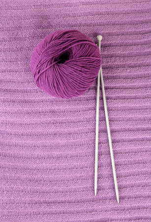 Purple sweater and a ball of wool close-up Stock Photo - 15773721