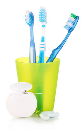 dental prophylaxis: Toothbrushes, chewing gum and dental floss isolated on white