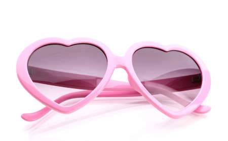 Pink heart-shaped sunglasses isolated on white photo