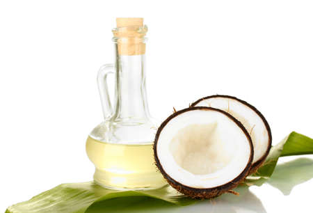with coconut: decanter with coconut oil and coconuts isolated on white
