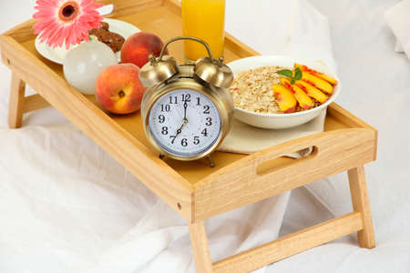 wooden tray with light breakfast on bed Stock Photo - 15773288