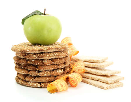 tasty crispbread, apple and measuring tape, isolated on white Stock Photo - 15772795