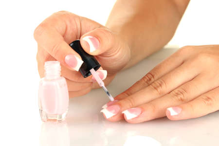Woman makes herself a French manicure, on white background Stock Photo - 15772775