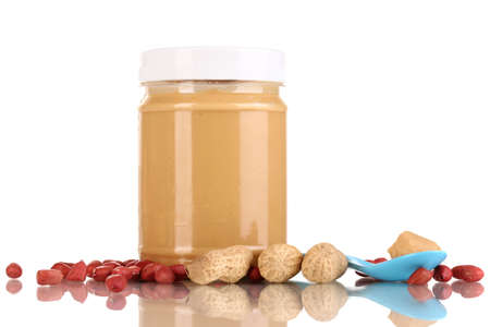 Delicious peanut butter in jar isolated on white Stock Photo - 15772553